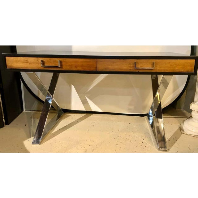 A Milo Baughman Mid-Century Modern vanity desk. This fully refinished desk or vanity having a walnut drawer front with an...