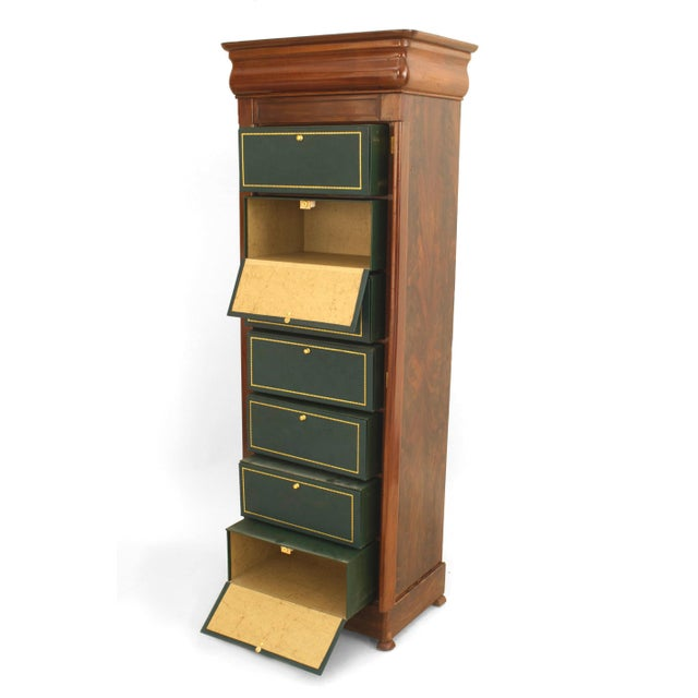 Continental (possibly Baltic) mahogany narrow chest of seven drawers (semainier) with green leather.