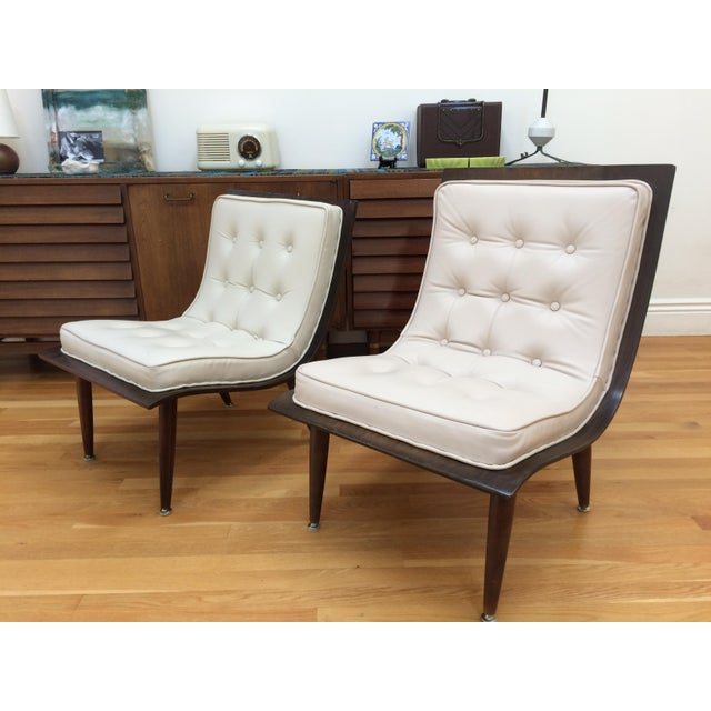 "Pair of vintage mid century ""scoop"" chairs manufactured by the Carter Brothers Inc., Salisbury, N.C., circa 1958 The..."