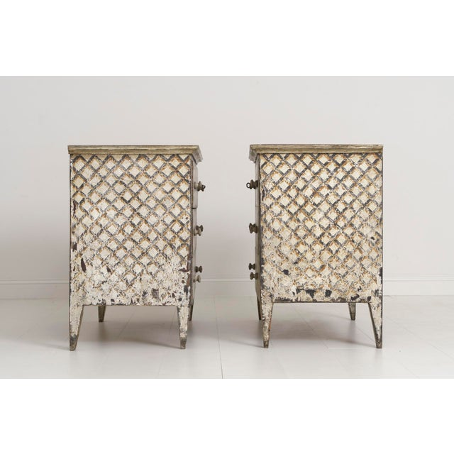 A stunning Italian Neoclassical style pair of large commodes with painted crosshatching design. These beautiful commodes...