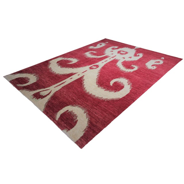 Hand knotted of top quality natural dyed wool and cotton in Afghanistan. This unique and innovative Ikat Rug is an eye...