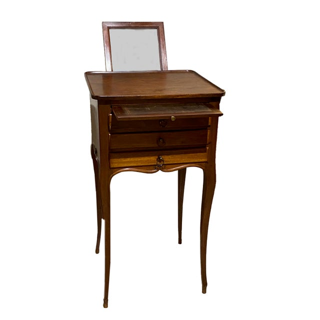 French Provincial table with mirror. Has three drawers and two pullouts. The front pullout is leather topped and the back...