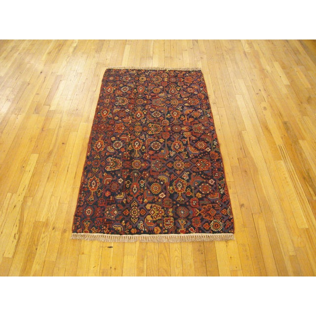 """Antique Persian N.W Persia Rug 4'10"""" H x 3'0"""" W , in Small Rug Size, circa 1920. This fine floral wool rug features a..."""