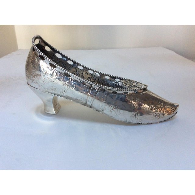 Life size silver shoe in sterling.