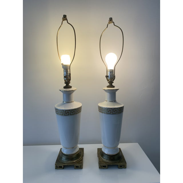 Gorgeous regency, off white porcelain table lamps with gold Greek key motif on body as well as base. Almost have a...