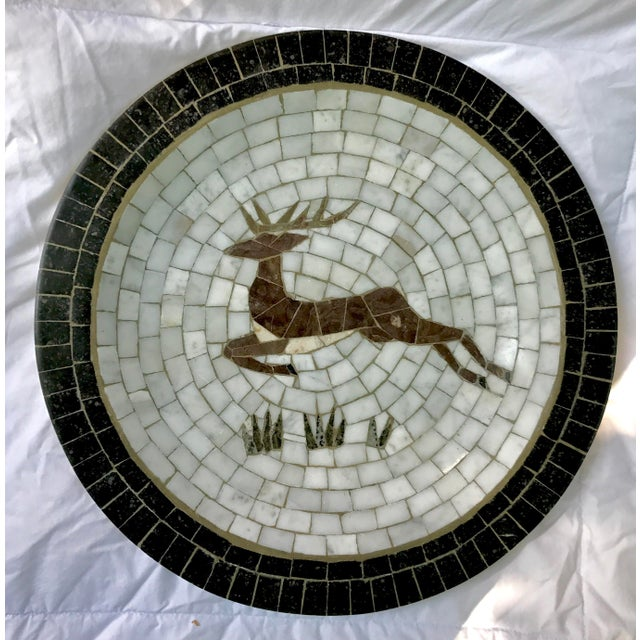 This is a large mid-century Mosaic plate of Danish design by Heide of Denmark. The piece has a Reindeer leaping over grass...