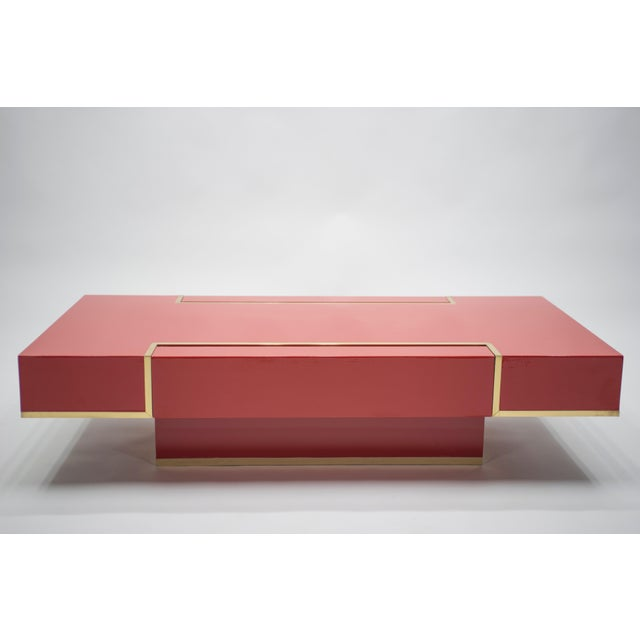 Cherry red lacquer and bright brass accents epitomize the bold, mid-century modern color palette of the 1970s, which feels...