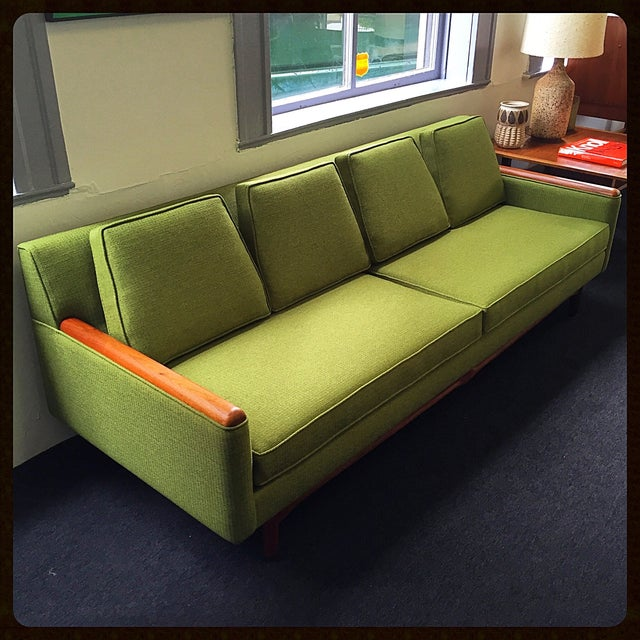 Classic Adrian Pearsall sofa with walnut base and arm rests. It has all new, high-quality foam and green upholstery. Very...