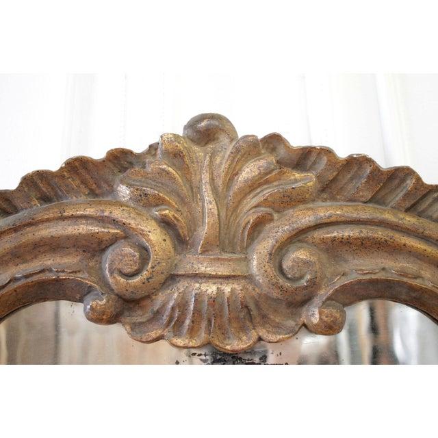 19th Century Italian Giltwood Mirror SKU Number: 9072-004222 Description: 19th century Italian giltwood mirror Original...