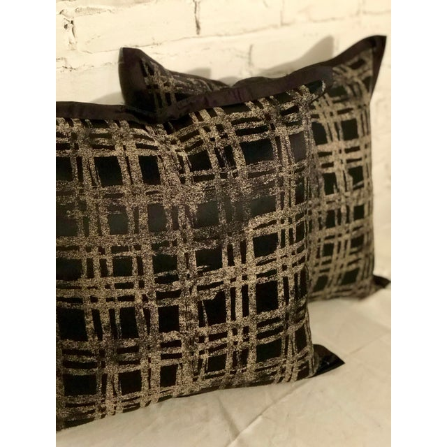 """Fabulous pair of 20"""" square flange edge pillows of black silk with abstract metallic gilt basketweave details on the..."""