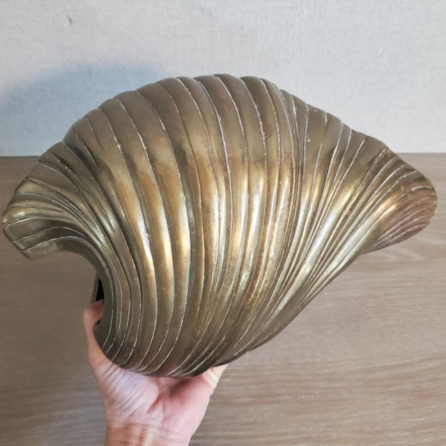 A vintage clam shell sculpture & planter made of solid brass. The scale and weight are incredible! Would look amazing as a...
