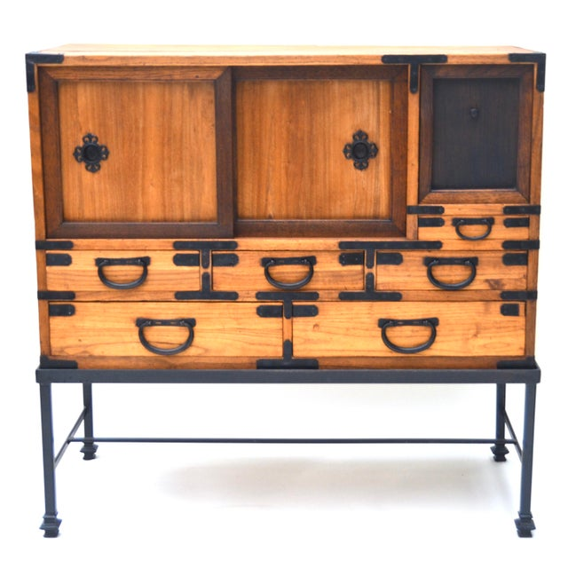 A beautiful antique Japanese Meiji Period merchant wood chest wood with iron warabite shaped drawer pulls on an iron base....