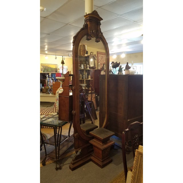 Huge walnut burlwood renaissance revival mirror which stands at 8' tall. In very good condition. Unusual front pedestal...