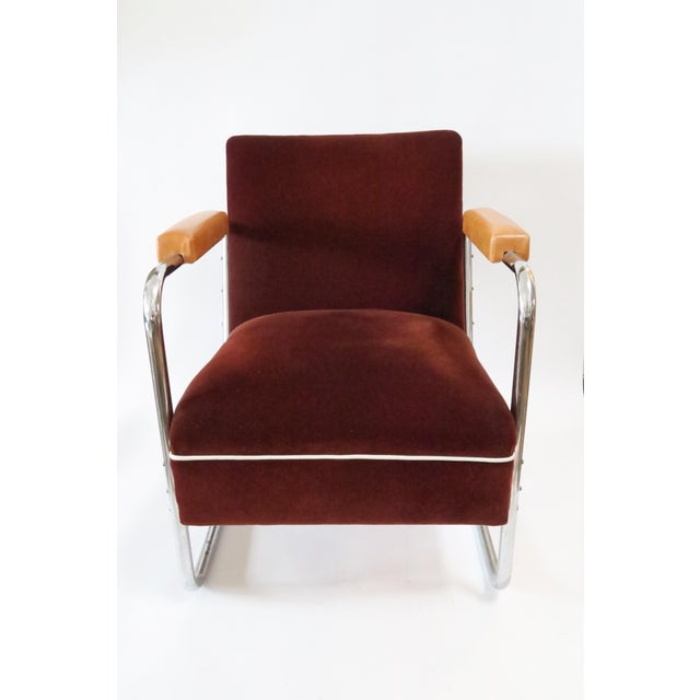 German chrome framed armchair with original mohair upholstery in cranberry color. Arm-pads recovered in leather. White...