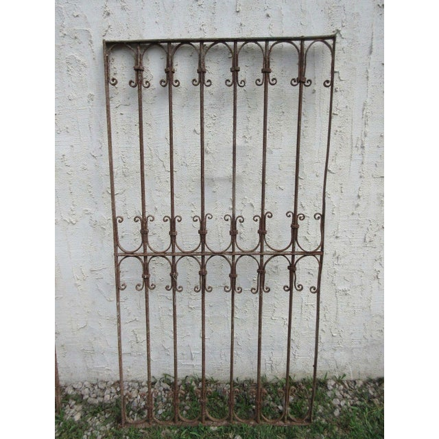 Wonderful piece of architecture. Heavy, tight and sturdy but this fence gate does show signs of age related wear including...