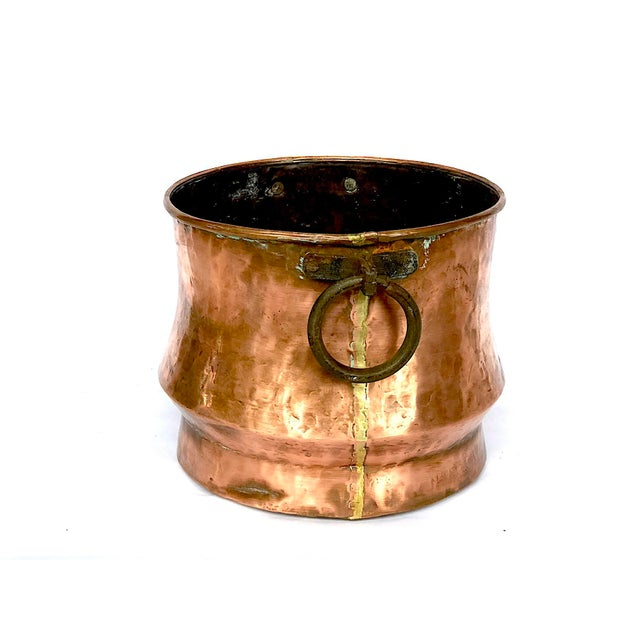 This vintage hammered copper planter pot has a nice patina of age, sturdy cast iron loop handles, and a generous width and...