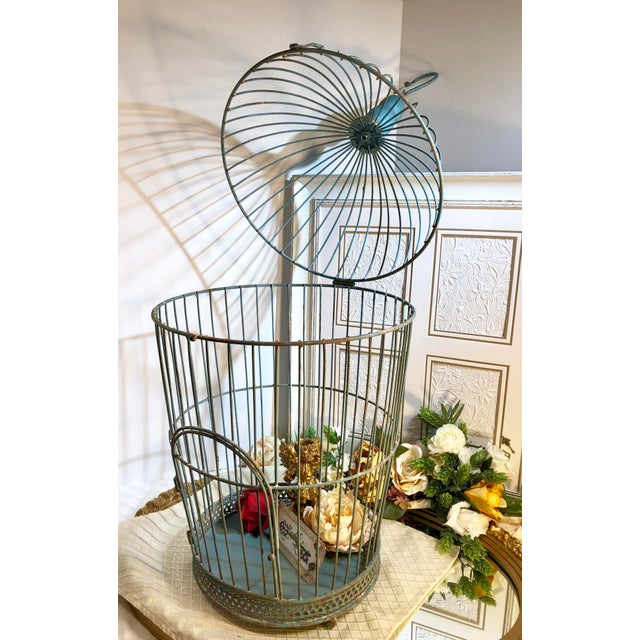"This is for a fun vintage ""shabby chic"" bird cage with metal vertical bars that are showing signs of use and it age which..."