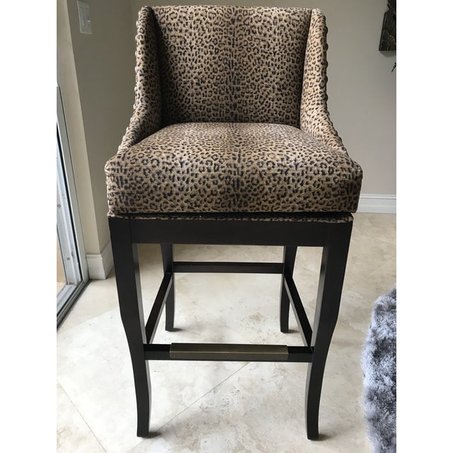 Set of 3 Custom upholstered barstools in gorgeous leopard print. Perfect for a Hollywood regency style home.