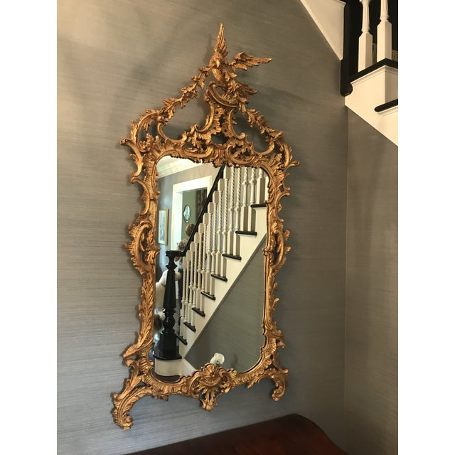 Ornate carved gold wood mirror. Has been the eye-catching centerpiece of our formal entry. Bird detail at the top. One...