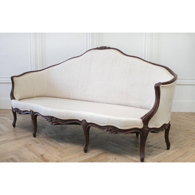 Late 19th Century Carved Walnut Sofa with Antique French Grainsack Upholstery Description: Late 19th century carved walnut...