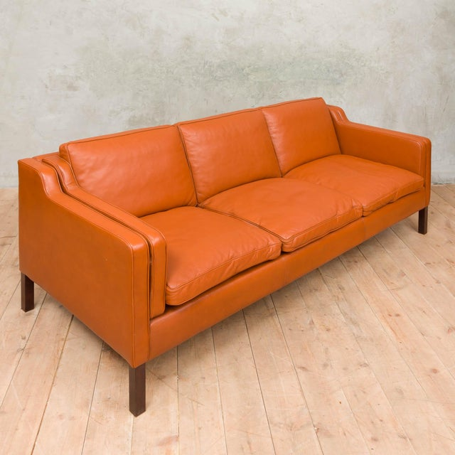 Made with superior quality thick aniline leather this elegant sofa, was made and designed in the 1970s by renowned Danish...