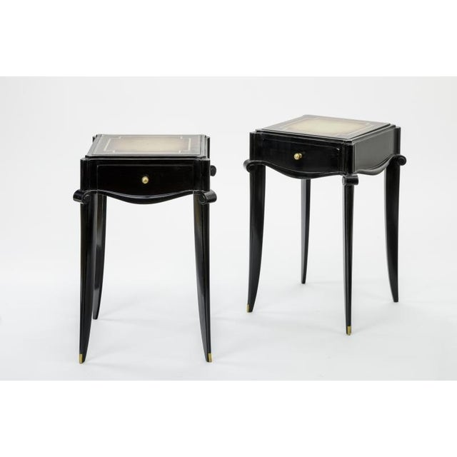 Jean Pascaud black lacquered wood and eglomise mirror and Gold Sabot bedside or Side Table.