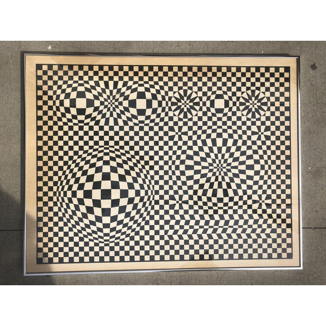 Vasarely was a French/Hungarian artist credited as the father of the op art movement. This piece is a framed lithograph,...