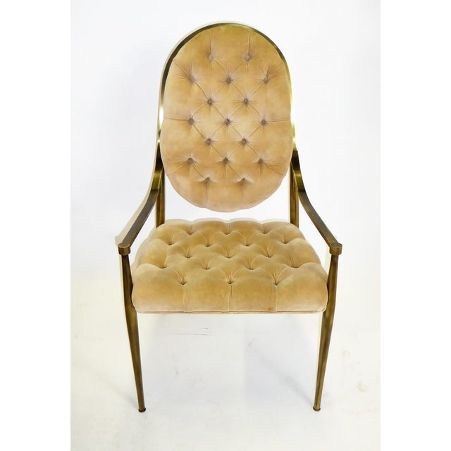 This is a set of 6 Mastercraft dining chairs with antiqued brass frames and tufted velvet upholstery. They are best...