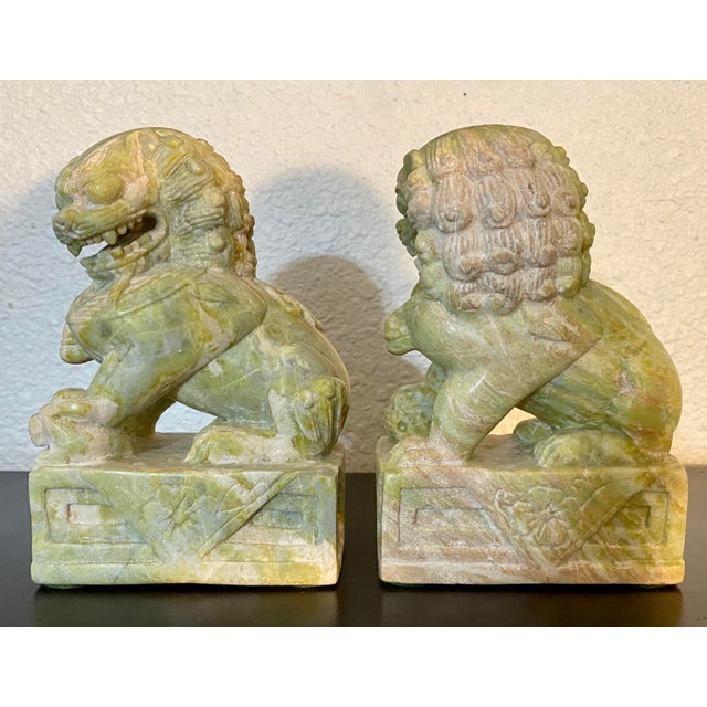 Handsome pair of vintage stone foo dogs. Vintage wear and patina. Excellent addition to your decor!