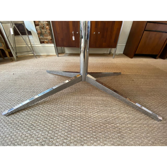 This mid century table is a true work of art. It appears to be knoll model 2485 I am however not positive. I couldn't find...