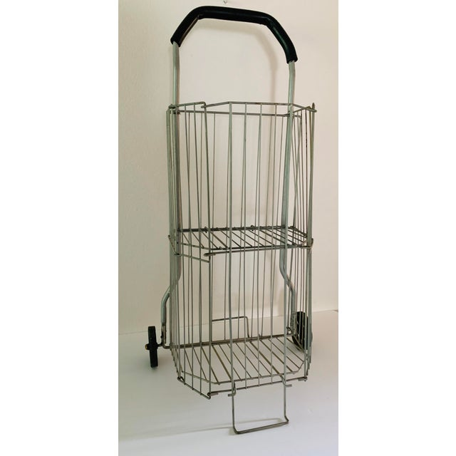 This sweet little vintage shopping cart folds down for compact storage, features two separate compartments. All ready for...