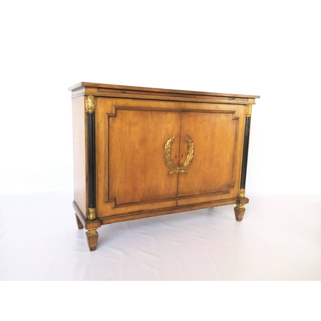 A very charming Italian neoclassical style sideboard. The gold-leaf wreath design adds beauty and character. Featuring two...