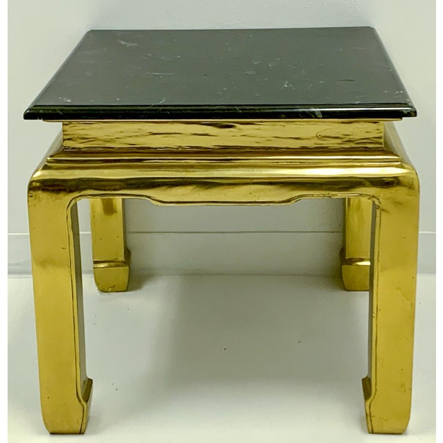 This is a very heavy casted brass table with marble top and Asian styling. This may be a Mastercraft piece.