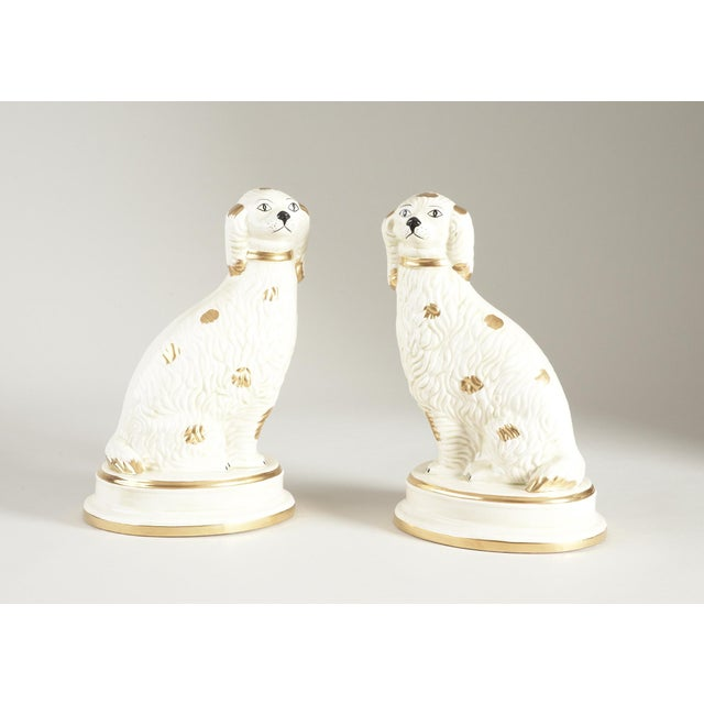 This is a pair of spaniel figurines by Chelsea House Inc. The pieces were hand painted on Italian ceramic.