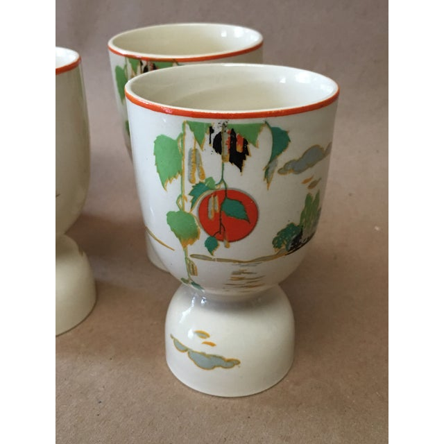 Breakfast is best! Lovely porcelain double egg cups decorated with serene, Asian inspired sea and landscape elements....