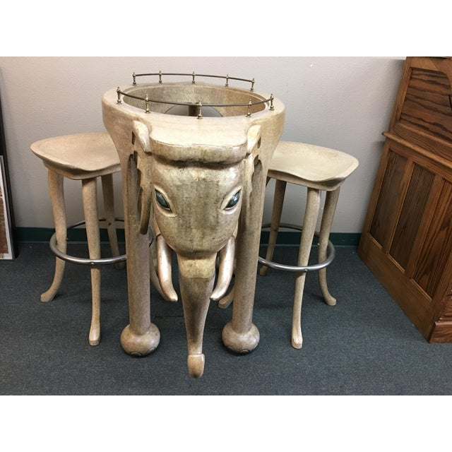 Design Plus Consignment Gallery presents a vintage bar set from Marge Carson. This unique bar has a brass-gallery and...