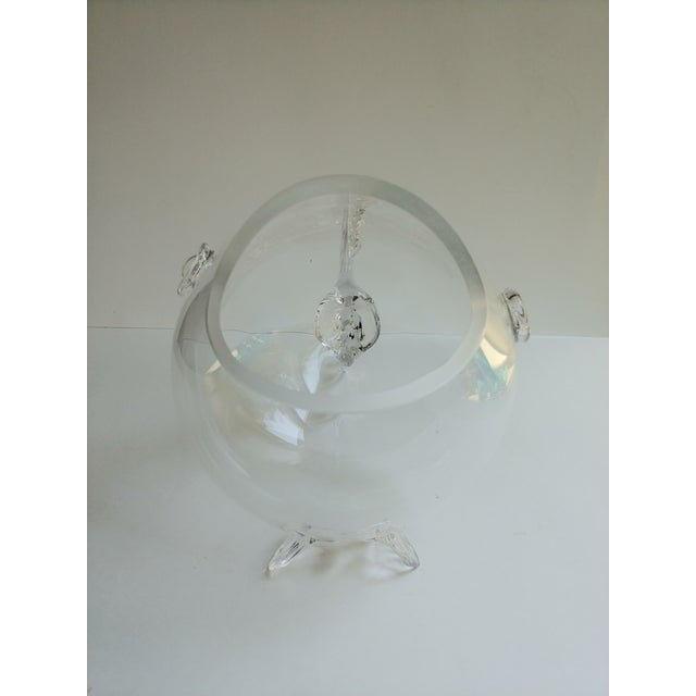 Many possible uses for this glass fish. Would be cute serving candy, holding bath bombs, or use as a fish bowl. *glass is...