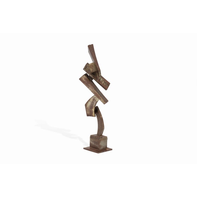 Here is a powerful brutalist metal sculpture by noted artist - Peter Calaboyias. This piece features striking angles,...