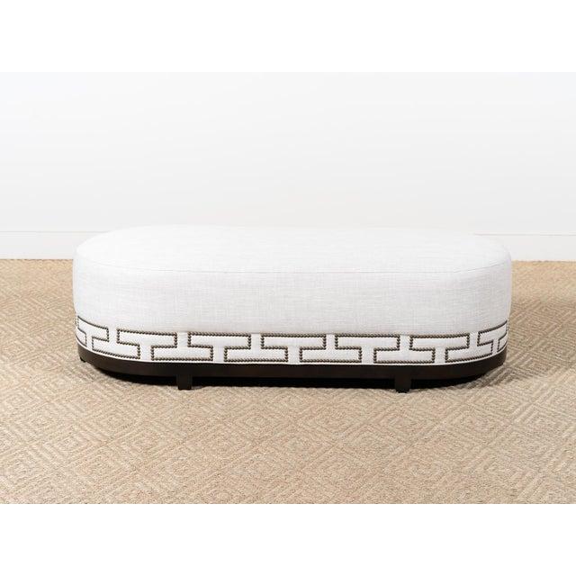 Upholstered oval bench Fabric: Honduras Tan (10) 100% Polyester Vintage nail head trim in Greek Key pattern Modern Elm...