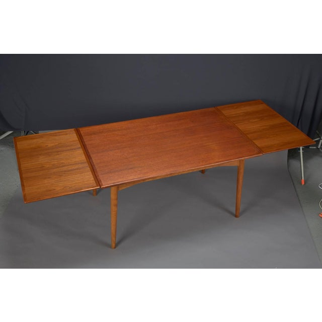 61cc079eb894d Beautiful midcentury Danish modern teak dining table crafted by Omann Jun s  Mobelfabrik. This table extends