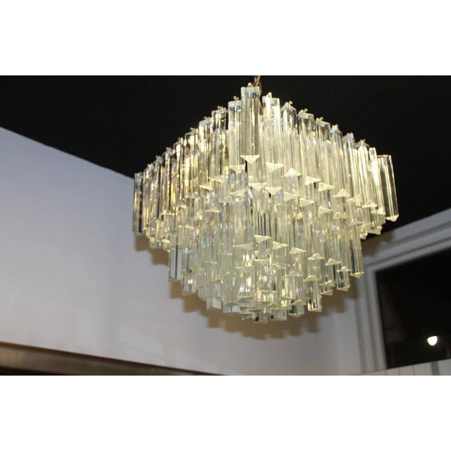 Vintage Murano Camer marked made in Italy (see pictures). Four bulbs, five tiers. Size does not include chain length....