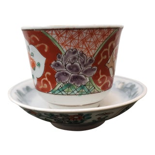 Circa 1880 Japanese Kakiemon Porcelain Floral Motif Tea Bowl and Saucer For Sale