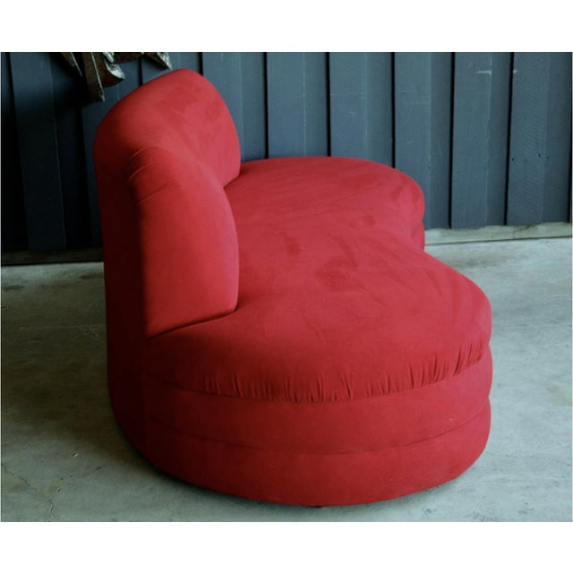 Cherry red micro-suede 1980's contemporary, Vladimir Kagan style sofa with curves in all the right places. Finished back...