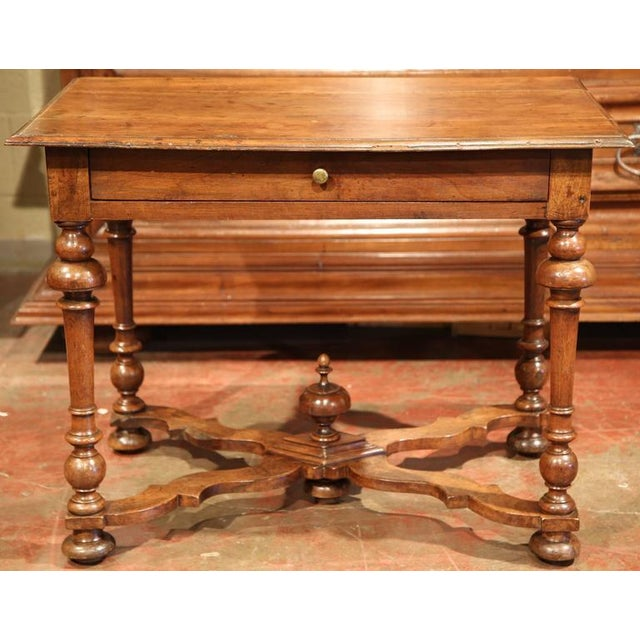 This elegant, antique fruitwood end table was crafted in the Perigord region of France, circa 1780. This side table has a...