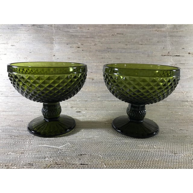Pair of textured emerald green champagne or dessert glasses.