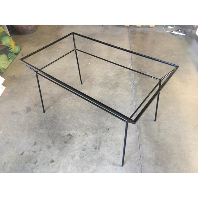 Rare Art Deco iron and glass outdoor dining Table featuring a Geometric form and petite frame. Circa 1940.