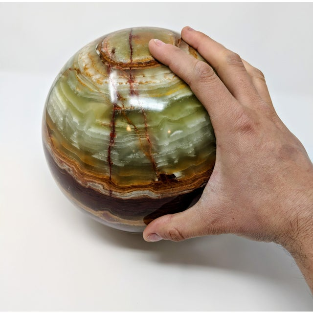 This onyx orb is 25 inches (over 600 millimeters) in circumference and weighs an impressive 26 pounds. A stunning mix of...