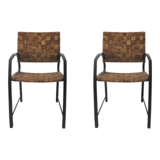 Transitional Woven Reed and Hammered Metal Arm Chairs Pair For Sale