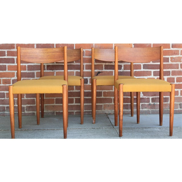 Set of four 1960s Danish Modern teak dining chairs. The chairs have been professionally reupholstered with new fabric and...