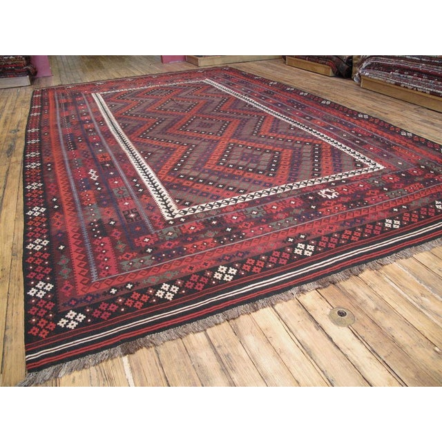 Very large tribal kilim from Afghanistan. Very high quality weave, great wool and attractive colors and design.